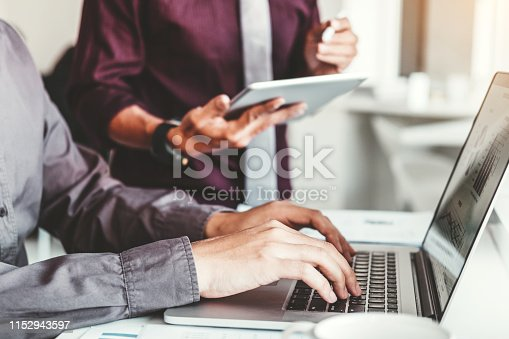 885956164istockphoto Co-working Business Team Consulting meeting Planning with digital tablet Strategy Analysis investment and saving concept. meeting discussing new plan financial graph data. 1152943597