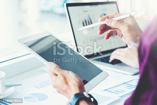 885956164istockphoto Co-working Business Team Consulting meeting Planning with digital tablet Strategy Analysis investment and saving concept. meeting discussing new plan financial graph data. 1169928933