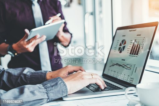 885956164istockphoto Co-working Business Team Consulting meeting Planning with digital tablet Strategy Analysis investment and saving concept. meeting discussing new plan financial graph data. 1169929037