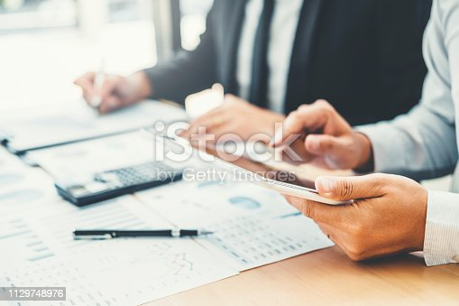 885956164istockphoto Co-working Business Team meeting Planning with digital tablet Strategy Analysis investment and saving concept. meeting discussing new plan financial graph data. 1129748976