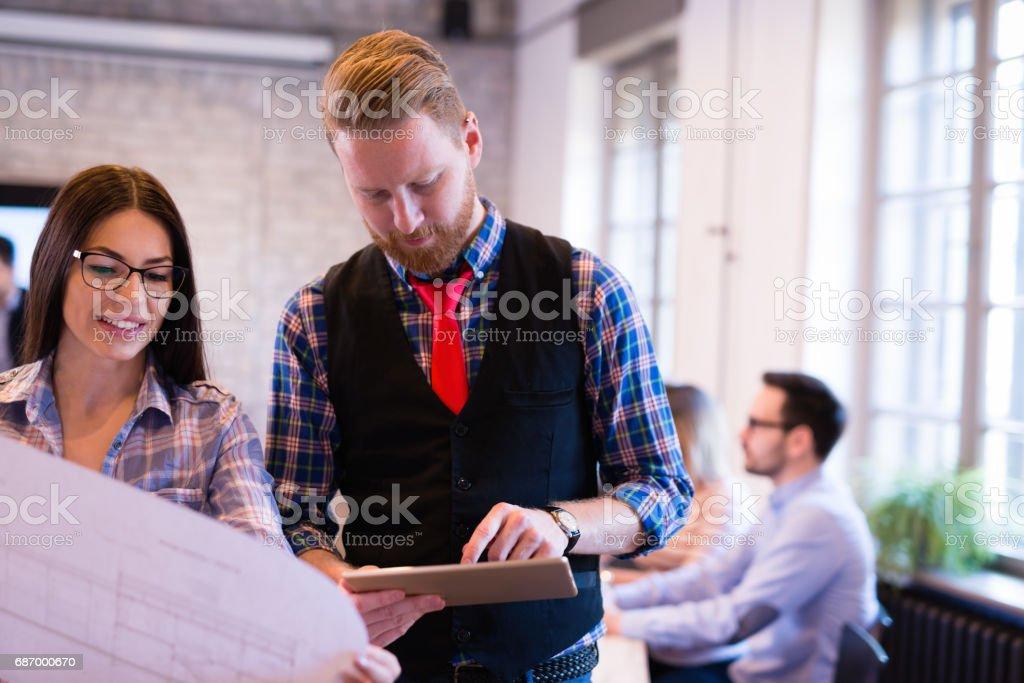 Coworking process, designers team working in modern office Lizenzfreies stock-foto