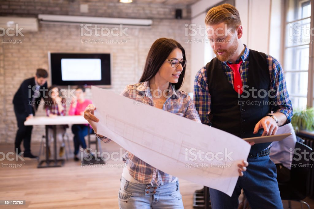 Coworking process, designers team working in modern office royalty-free stock photo