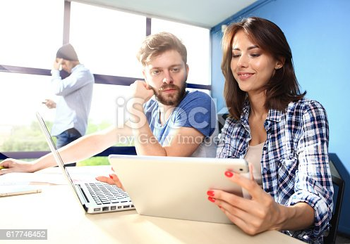 517496962 istock photo Coworking process, designers team working modern office 617746452