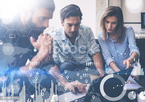 912675036 istock photo Coworking process in a sunny office.Young Business team making discussing at office.Concept of digital diagram,graph interfaces,virtual screen,connections icon.Horizontal,blurred background. 912611350