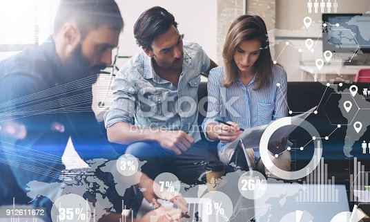 912675036istockphoto Coworking process in a sunny office.Young Business team making great sratup idea at meeting room.Concept of digital diagram,graph interfaces,virtual screen,connections icon on blurred background. 912611672