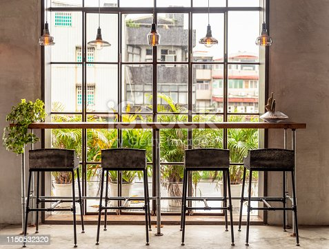Four stools at a table ready for use in a coworking office in the Taiwanese capital, Taipei.