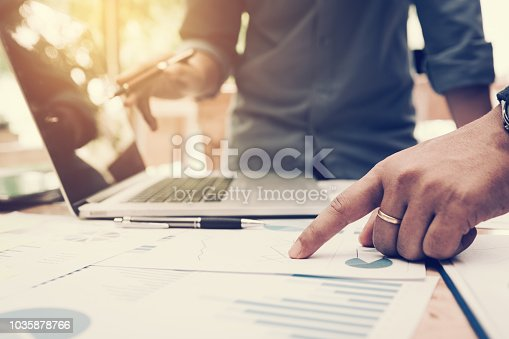 885956164istockphoto Co-working space office with group start-up analysis to data paper chart on desk. 1035878766