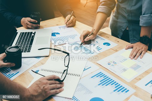 885956164istockphoto Co-working space office with group start-up analysis to data paper chart on desk. 921660032