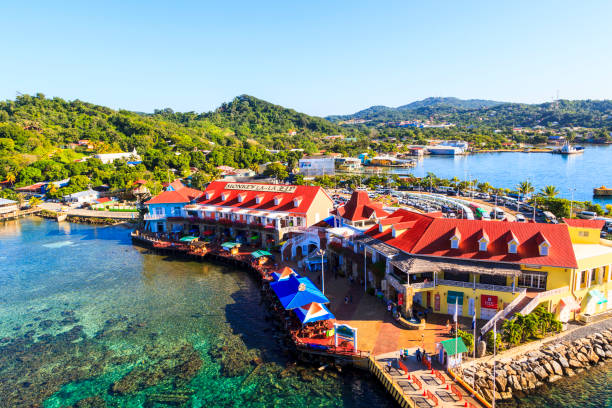 Coxen Hole Roatan Island Honduras Jan 28 2016: Coxen Hole, also called Roatan Town is the largest city on the island and also the capital of the Bay Islands of Honduras with a population of 5070. The island in the Caribbean, about 65 kilometers off the northern coast of Honduras. roatan stock pictures, royalty-free photos & images