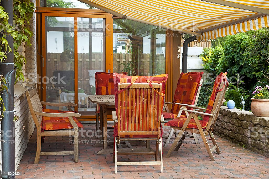 Cozily decorated patio with warm, inviting color palette stock photo