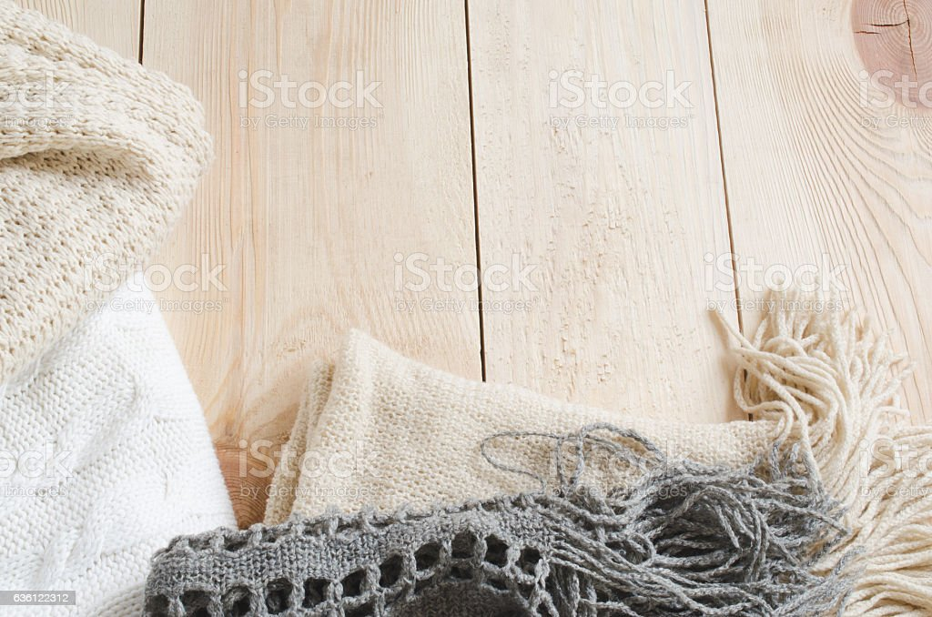 Cozy and soft winter background. Warm knitted clothes. stock photo