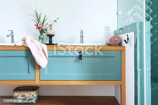 istock Cozy and stylish bathroom in warm colours and natural wooden shelf. 1030845788