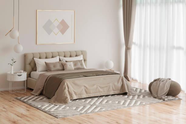 gemütliches schlafzimmer in warmen farben mit malerei, nachttisch, einem pouf und einem karierten - schlafzimmer stock-fotos und bilder