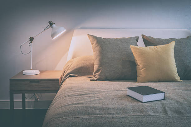 Cozy Bedroom Interior With Book And Reading Lamp Stock Photo