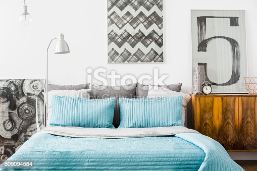 Photo of modern cozy bedroom with matrimonial bed