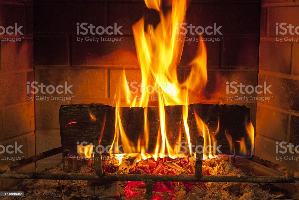 cozy blazing fire in fireplace royalty-free stock photo