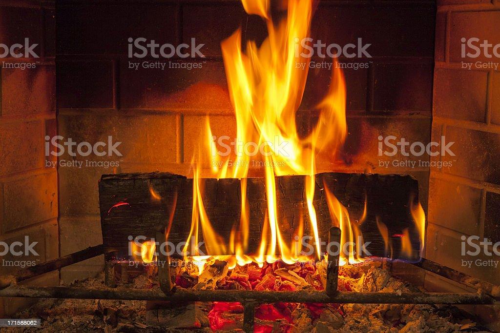cozy blazing fire in fireplace stock photo