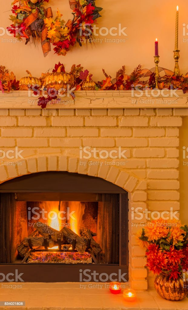 Cozy Brick fireplace with fall decorations and candles (P) stock photo
