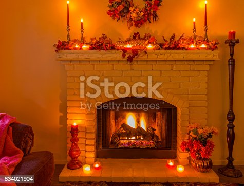 istock Cozy Brick fireplace with fall decorations and candles (P) 834021904
