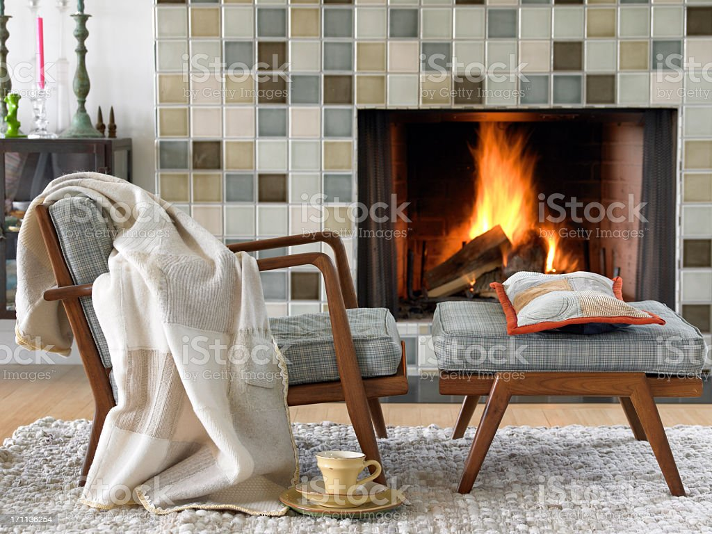 cozy by the fire stock photo
