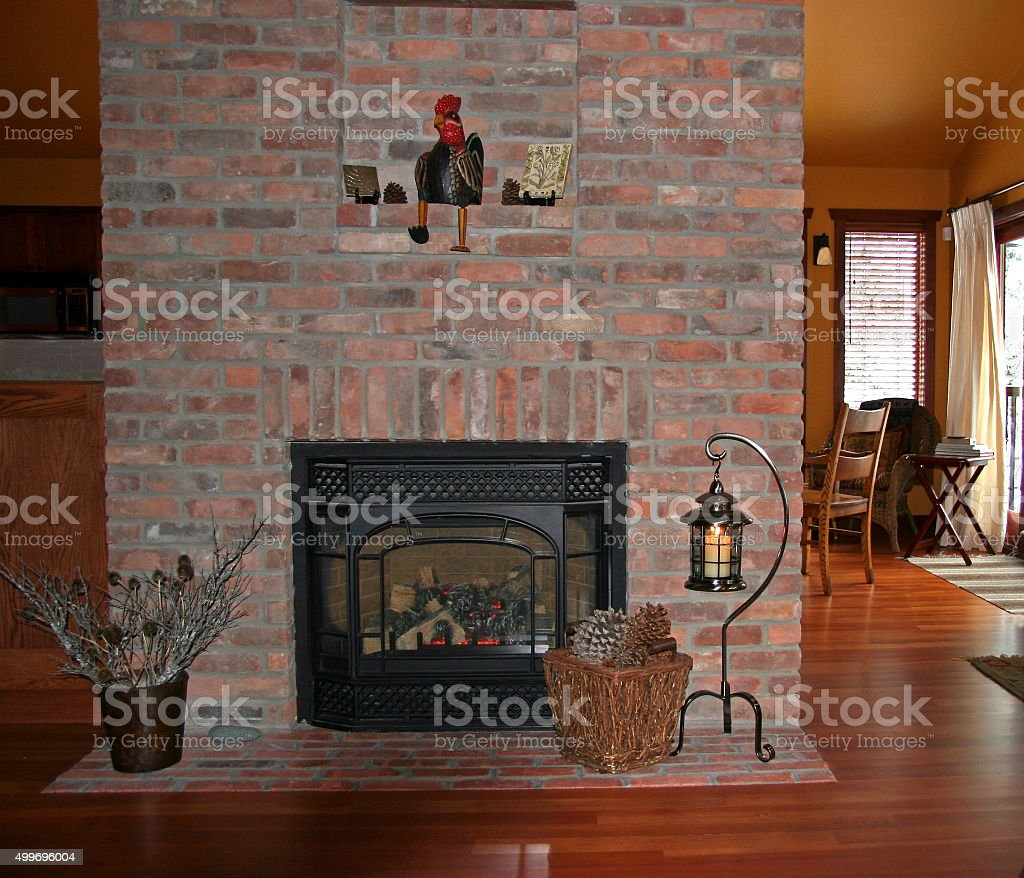 cozy cabin with antique brick fireplace stock photo 499696004 istock