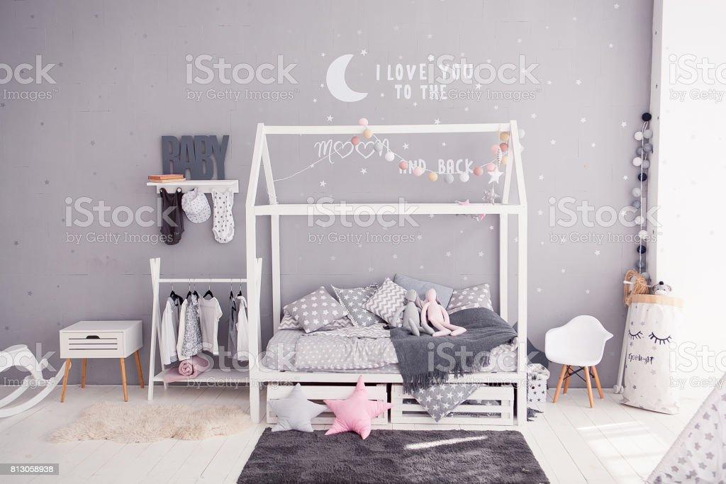 Cozy children's bedroom in scandinavian style with diy accessories stock photo