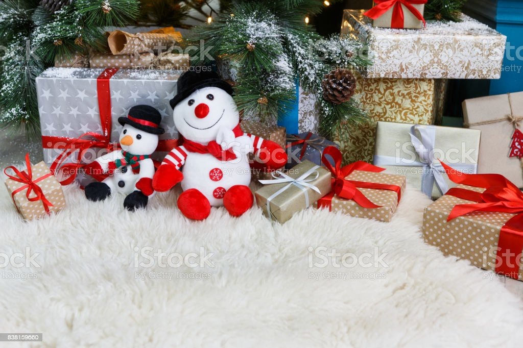 Cozy Christmas Background Toy Snowmen And Presents Under New