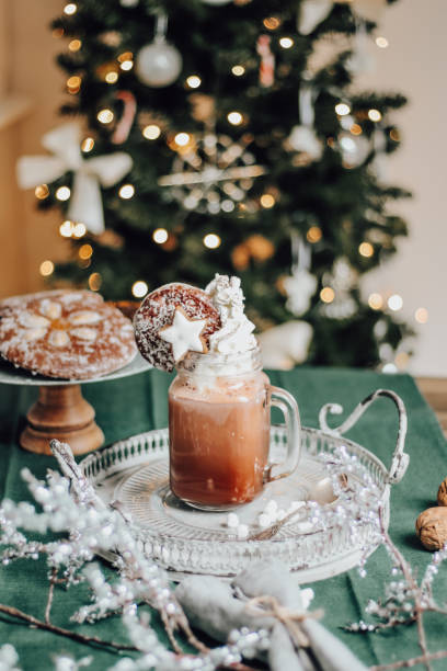 Cozy Christmas Coffee with whipped cream and gingerbread stock photo