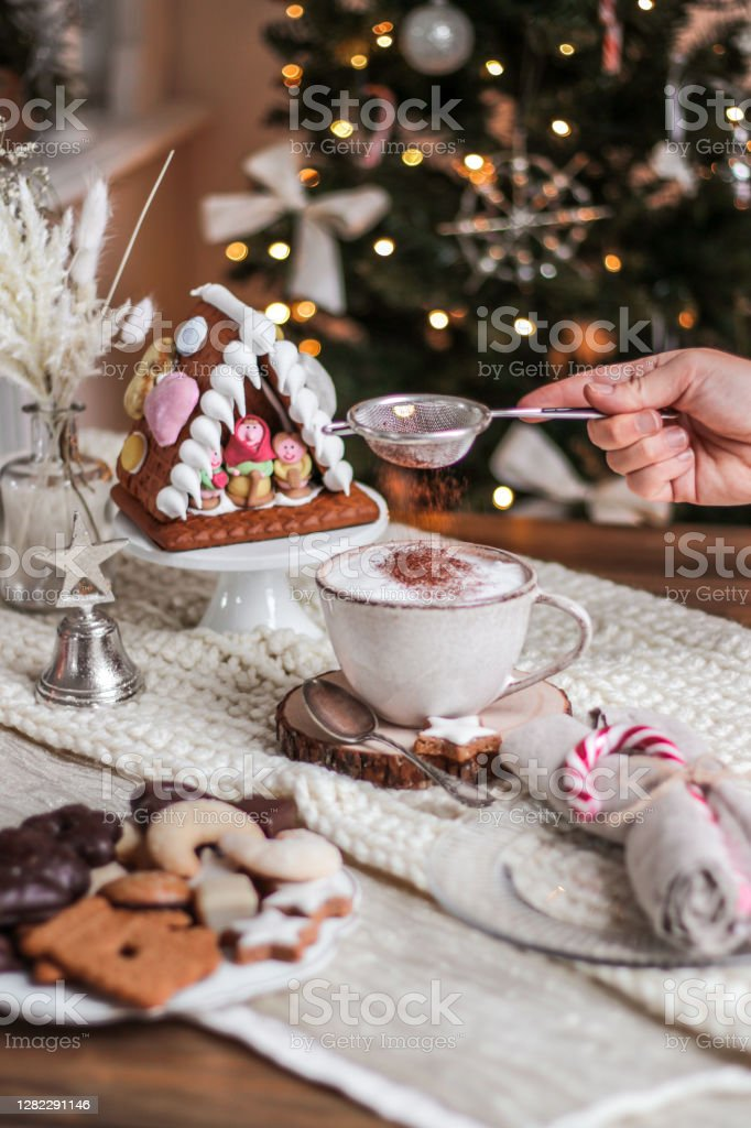 Cozy Christmas Hot Chocolate with cookies and christmas tree Christmas Hot Chocolate with cookies and Christmas tree in rustic kitchen Backgrounds Stock Photo
