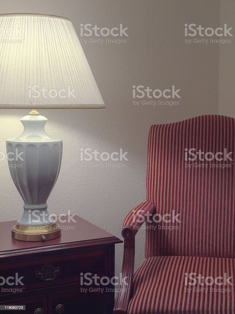 Cozy Corner with arm chair and lamp stock photo
