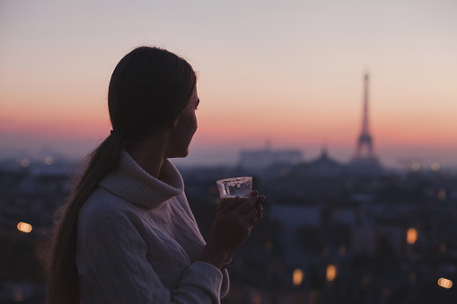 cozy evening in cafe in Paris, woman drinking hot chocolate