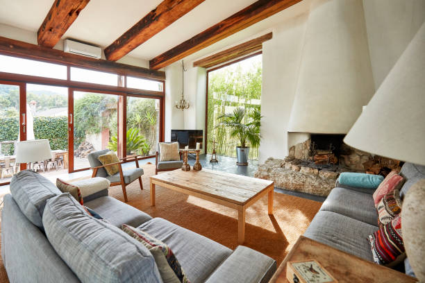Cozy fireplace in a Mediterranean farmhouse living room stock photo