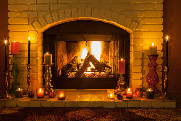 ... Cozy fireplace setting with candles (P) stock photo ...