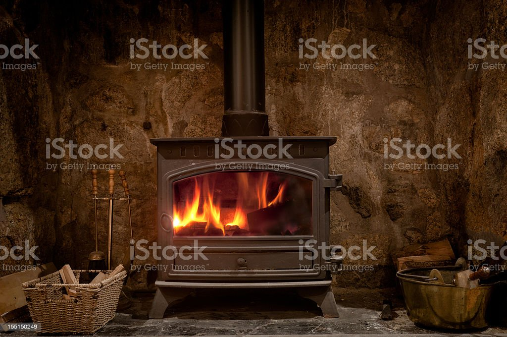 Cozy Fireplace With A Wood Burning Stove stock photo