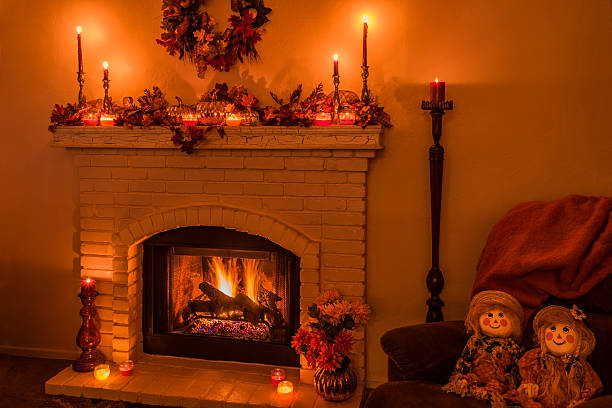 cozy fireplace with fall decorations and candles(p) - herbst girlande stock-fotos und bilder