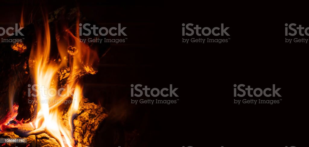 Cozy fireplace. Wood logs burning, relaxation and warm home stock photo