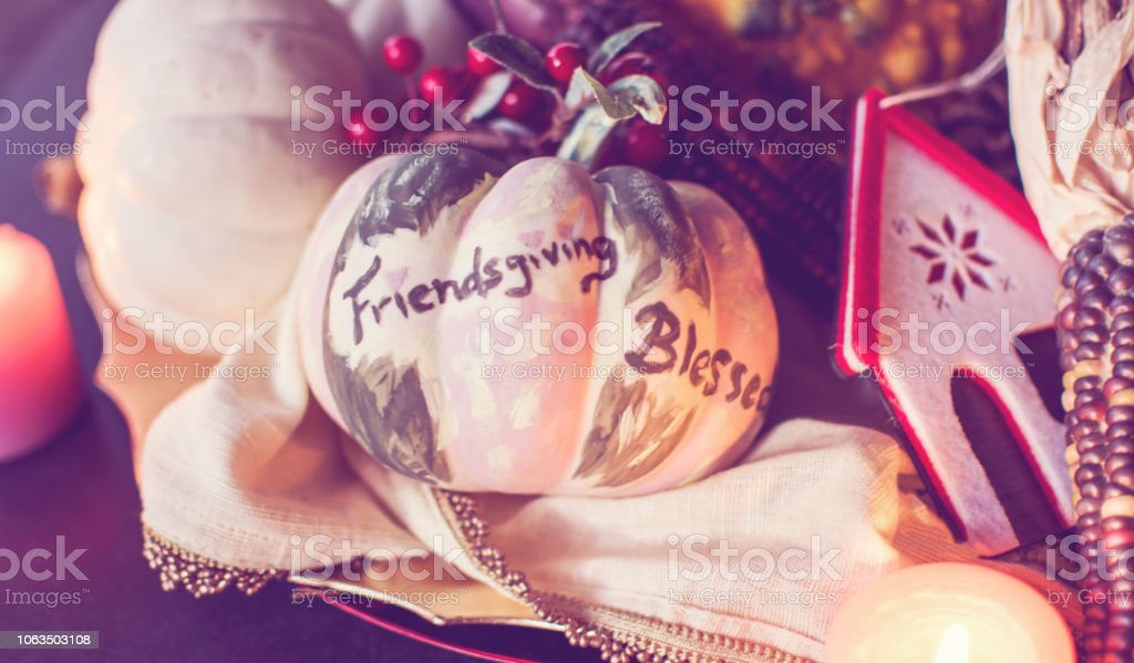 Cozy Friendsgiving background for Thanksgiving card or invitations  for Friends pot luck celebration stock photo