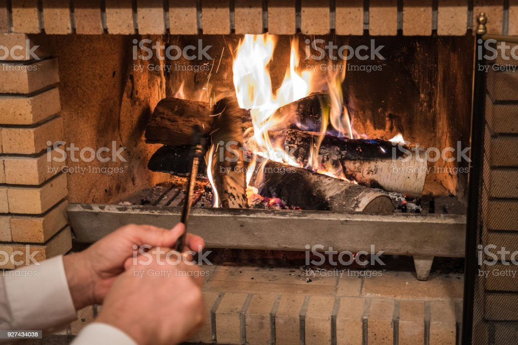 Cozy home atmosphere near the fireplace stock photo