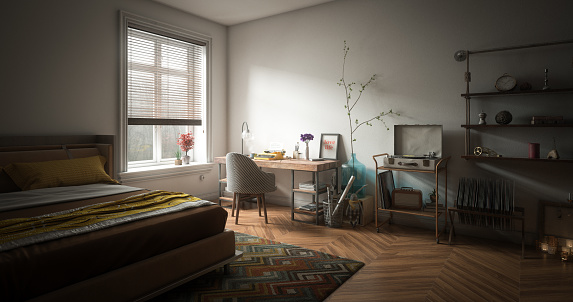 Digitally generated cozy and messy home interior design with a small workplace, double bed and lots of home props.  The scene was rendered with photorealistic shaders and lighting in Autodesk® 3ds Max 2016 with V-Ray 3.6 with some post-production added.