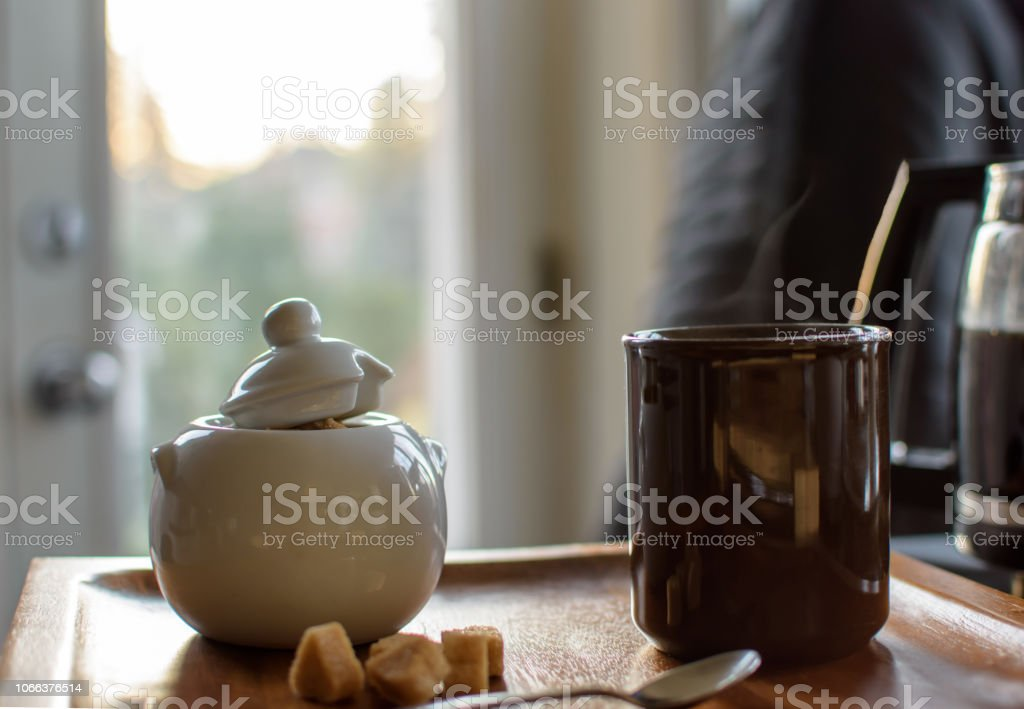 Cozy kitchen cup of coffee with raw sugar stock photo