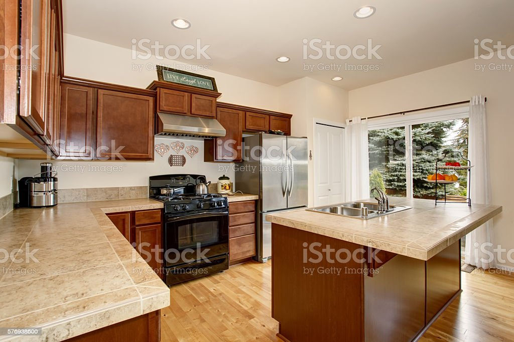 Cozy Kitchen Room With Tile Counter Top Kitchen Island Stock Photo & More  Pictures of Apartment