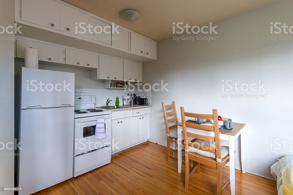 Cozy kitchen with a small dinner table. Interior design. stock photo