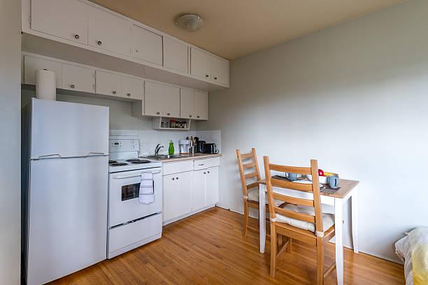 cozy kitchen with a small dinner table. interior design. - pequeño fotografías e imágenes de stock