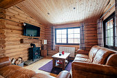 Photograph of a living room in a log cabin.
