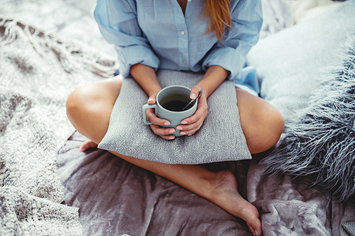 Cozy morning with coffee in the bed