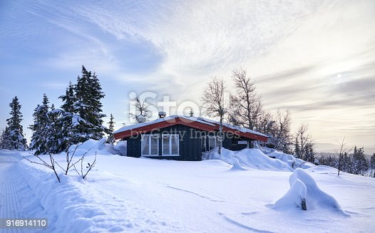 Simple cabin after heavy snowfall in the Norwegian mountains.