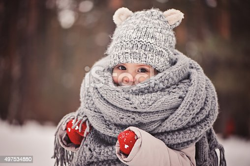 istock cozy outdoor portrait of happy toddler child girl in winter 497534880