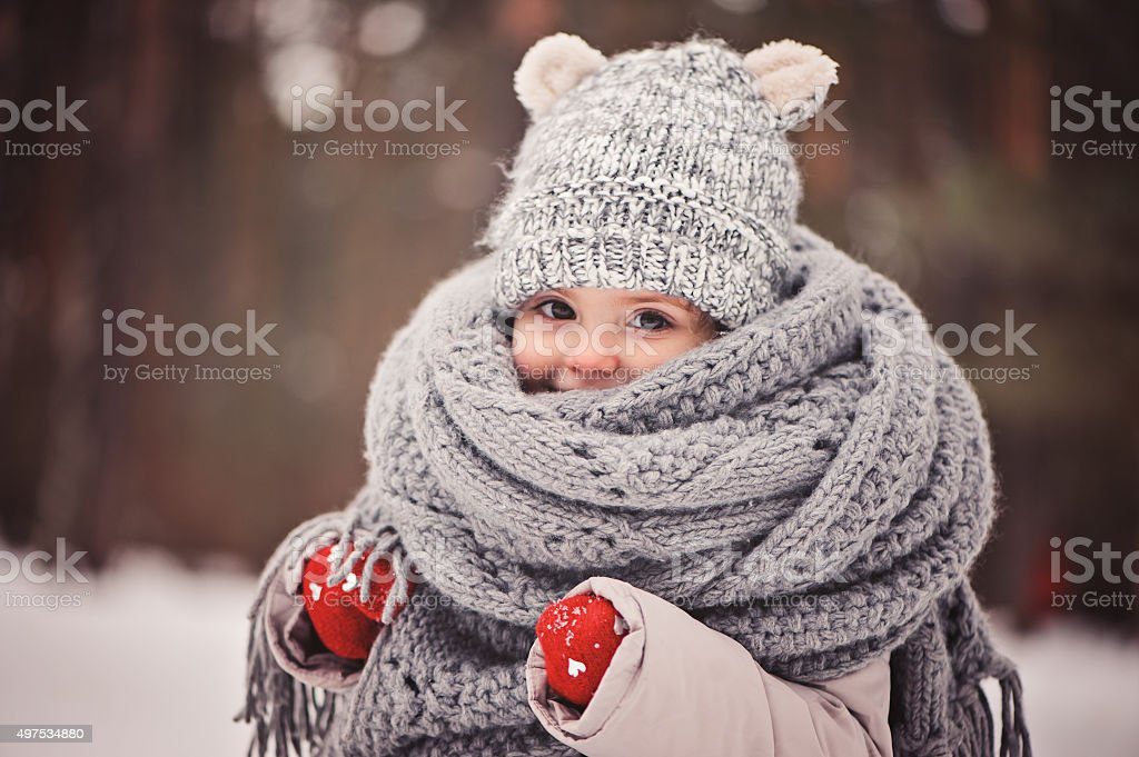 cozy outdoor portrait of happy toddler child girl in winter stock photo