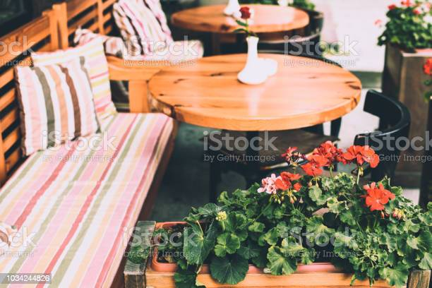 Cozy outdoor summer space in a cafe comfortable chairs and classic picture id1034244826?b=1&k=6&m=1034244826&s=612x612&h=0z iju 3 gfs zidziczwc4teyp0rscubgdrdpjdezi=