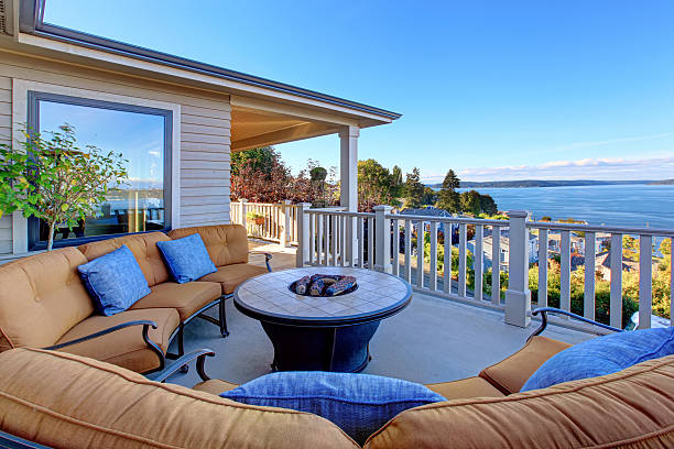 Cozy patio area with Puget Sound view. Tacoma, WA Cozy patio area with comfort settees and fire pit. Deck with Puget Sound view. Tacoma, WA pierce county washington state stock pictures, royalty-free photos & images